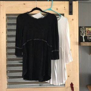 Pair of black and ivory tunics